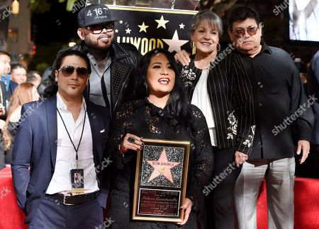 Stock Image of Chris Perez, Suzette Quintanilla, A.B. Quintanilla III, Abraham Quintanilla Jr., Marcella Ofelia Samora. Suzette Quintanilla, center, sister of the late singer Selena Quintanilla, holds a replica of her new star on the Hollywood Walk of Fame as she poses with, from left, Selena's former husband Chris Perez, her brother A.B. Quintanilla III, and her parents Marcella Ofelia Samora and Abraham Quintanilla Jr. during a posthumous star ceremony for Selena on the Hollywood Walk of Fame, in Los Angeles