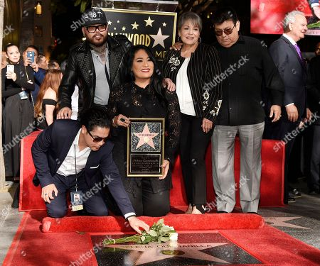 Stock Picture of Chris Perez, Suzette Quintanilla, A.B. Quintanilla III, Abraham Quintanilla Jr., Marcella Ofelia Samora. Chris Perez, bottom left, the former husband of the late singer Selena Quintanilla, puts flowers down on her new star on the Hollywood Walk of Fame as he poses with, left to right, Selena's brother A.B. Quintanilla III, her sister Suzette, and her parents Marcella Ofelia Samora and Abraham Quintanilla Jr. during a posthumous star ceremony on the Hollywood Walk of Fame, in Los Angeles