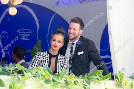 James Magnussen and Rose McEvoy enjoy themselves in the Lavazza marquee at the Melbourne Cup Carnival