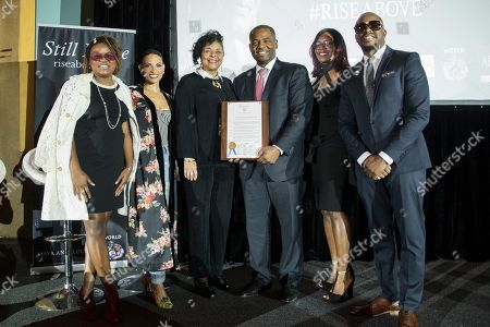 Ceasar Mitchell, Park Cannon, Goapele, Raheem DeVaughn. Georgia State Representative Park Cannon, left, joins Atlanta City Council President Ceasar Mitchell holds the proclamation to honor R&B sensations, Goapele, second from left, Raheem DeVaughn, right, and the creators of the RISE Above HIV national campaign, presented by AIDS Healthcare Foundation in Atlanta, GA at the Fox Theater on