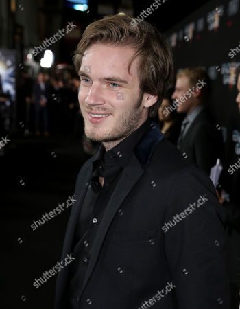 """Felix Kjellberg, aka PewDiePie, arrives at the Los Angeles premiere of """"Ender's Game"""" at TCL Chinese Theatre in Los Angeles. YouTube's top-earning celebrity is a 25-year-old video-game-playing jokester who took in $12 million in the year ending June 1, 2015. Forbes magazine says Kjellberg tops its first list of people who have spun short online videos into huge piles of cash"""
