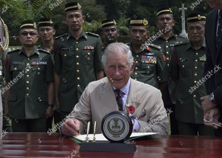 Prince Charles signed the visitors book when visited the Taiping Commonwealth War Graves Cemetery  On arrival at the cemetery, His Royal Highness was greeted by Mr Paul Price, the Commonwealth War Graves Commissioner, and Colonel Stephen Hall, British Defence Advisor to Malaysia. The Prince first visited the Muslim Cemetery to lay a wreath at the Stone of Remembrance. HRH spoke to local community members about their work caring for the cemetery. Proceeding to the Christian Cemetery, The Prince laid a wreath at the Cross of Sacrifice. His Royal Highness then met representatives from local and national veterans' groups as well as other Commonwealth Defence Advisers
