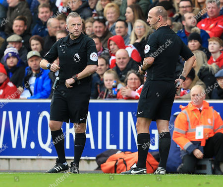 Referee R Madley (right) is substituted by 4th official J Moss (left)