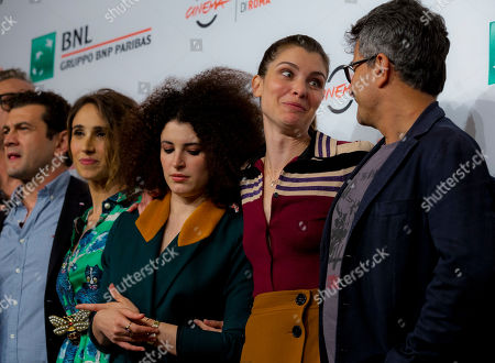 Vinicio Marchioni, Silvia D'Amico, Marianne Mirage, Vittoria Puccini, Paolo Genovese. From left, actors Vinicio Marchioni, Silvia D'Amico, Marianne Mirage, Vittoria Puccini, and director Paolo Genovese pose during the photo call for the movie 'The Place' at the 12th Rome Film Fest in Rome