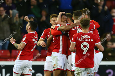 Stock Image of Barnsley's Zeki Fryers is congratulated on scoring his sides second goal from a long range free kick which bounces through the box and past a helpless Tomasz Kuszczak of Birmingham City