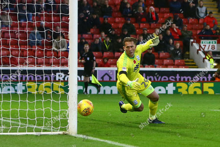 Tomasz Kuszczak of Birmingham City is left helpless as Barnsley's second is scored from a free kick