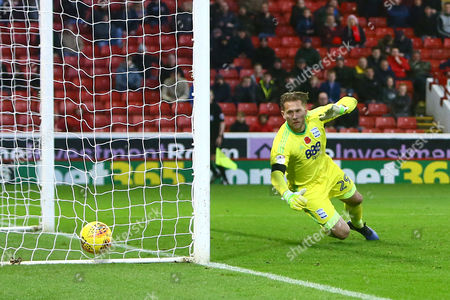 Stock Photo of Tomasz Kuszczak of Birmingham City is left helpless as Barnsley's second is scored from a free kick