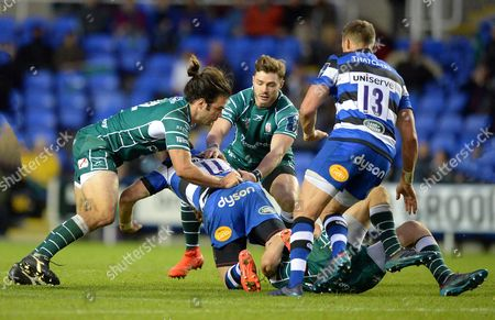 Luke McLean of London Irish and Ben Ransom of London Irish with the tackle on Jack Wilson of Bath Rugby during the Anglo-Welsh Cup match between London Irish and Bath Rugby at Madejski Stadium on November 4th 2017 in Reading, Berkshire, England. (Photo by Gareth Davies/PPAUK)