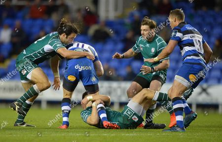 Luke McLean of London Irish, Theo Brophy Clews of London Irish and and Ben Ransom of London Irish with the tackle on Jack Wilson of Bath Rugby during the Anglo-Welsh Cup match between London Irish and Bath Rugby at Madejski Stadium on November 4th 2017 in Reading, Berkshire, England. (Photo by Gareth Davies/PPAUK)