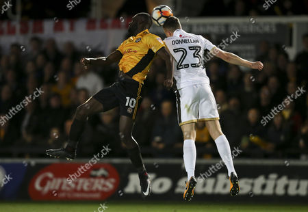 Frank Nouble of Newport County and Shaun Donnellan of Walsall compete for the ball