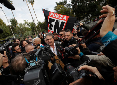 Italian far-right wing party Forza Nuova leader Roberto Fiore talks with reporters as he arrives at a demonstration against the government-proposed reform of the citizenship procedures for the descendants of immigrants living in Italy, in Rome