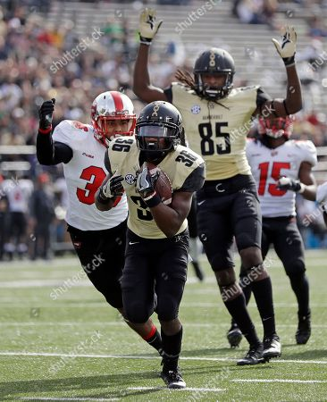 Trey Ellis, Chris Pierce, Kyle Bailey. Vanderbilt wide receiver Trey Ellis (36) scores a touchdown ahead of Western Kentucky linebacker Kyle Bailey (36) after Ellis caught a pass that bounced off wide receiver Chris Pierce (85) in the first half of an NCAA college football game, in Nashville, Tenn