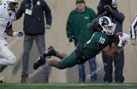 Felton Davis III, Christian Campbell. Michigan State wide receiver Felton Davis III (18), defended by Penn State cornerback Christian Campbell (1), catches a 33-yard pass and falls into the end zone for a touchdown during the second half of an NCAA college football game, in East Lansing, Mich