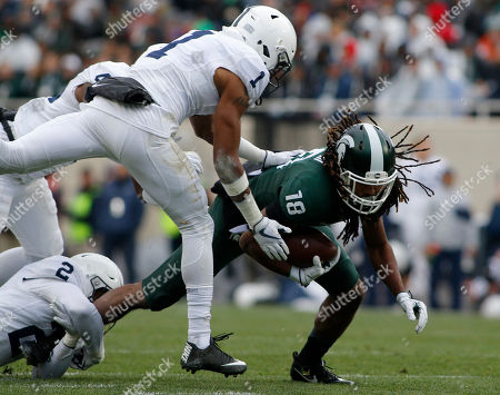 Felton Davis III, Christian Campbell, Marcus Allen. Michigan State receiver Felton Davis III, right, is stopped by Penn State's Christian Campbell (1) and Marcus Allen (2) during the first quarter of an NCAA college football game, in East Lansing, Mich. Michigan State won 27-24