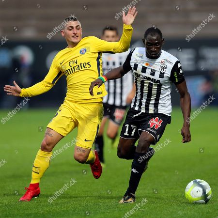 Paris Saint Germain's Marco Verrati, left, challenges for the ball with Angers' defender Saliou Ciss during their French League One soccer match, in Angers, western France