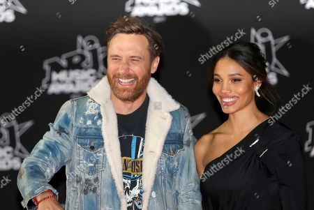 David Guetta, Jessica Ledon. French DJ and producer of electro music, David Guetta, left, arrives with his partner Jessica Ledon at the Cannes festival palace, to take part in the NRJ Music awards ceremony, in Cannes, southeastern France