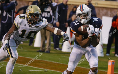 University of Virginia Cavalier WR #14 Andre Levrone catches a touchdown pass in front of Georgia Tech Yellow Jackets DB #10 Christian Campbell during NCAA football game between the University of Virginia Cavaliers and the Georgia Tech Yellow Jackets at Scott Stadium in Charlottesville, Virginia