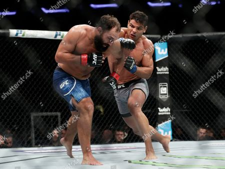 Johny Hendricks, Paulo Costa. Paulo Costa, of Brazil, punches Johny Hendricks, left, during a middleweight mixed martial arts bout at UFC 217, in New York. Costa won the fight