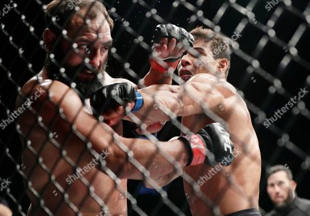 Johny Hendricks, Paulo Costa. Johny Hendricks, left, is punched by Paulo Costa, of Brazil, during a middleweight mixed martial arts bout at UFC 217, in New York. Costa won the fight