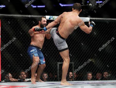 Johny Hendricks, Paulo Costa. Paulo Costa, right, of Brazil, kicks Johny Hendricks, left, during a middleweight mixed martial arts bout at UFC 217, in New York. Costa won the fight