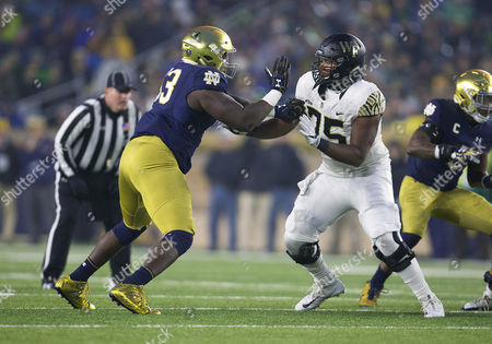 Notre Dame defensive lineman Jay Hayes (93) and Wake Forest offensive lineman Justin Herron (75) battle at the line of scrimmage during NCAA football game action between the Wake Forest Demon Deacons and the Notre Dame Fighting Irish at Notre Dame Stadium in South Bend, Indiana. Notre Dame defeated Wake Forest 48-37