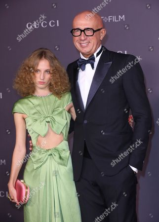Petra Collins, Marco Bizzarri. Petra Collins, left, and Gucci CEO Marco Bizzarri arrives at the LACMA Art + Film Gala at the Los Angeles County Museum of Art on in Los Angeles