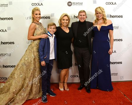 """Stock Image of Savannah Chrisley, far left, her brother Grayson, their parents Julie and Todd Chrisley from the TV show """"Chrisley Knows Best"""", pose on the red carpet with Erica Greve, founder and CEO of Unlikely Heroes, before the Unlikely Heroes 5th Annual Recognizing Heroes Charity Benefit, in Irving, Texas"""