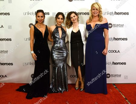 Comedian Anjelah Johnson, Actress Francia Raisa, Producer Mandy Teefey and Erica Greve, founder and CEO of Unlikely Heroes, pose on the red carpet before the Unlikely Heroes 5th Annual Recognizing Heroes Charity Benefit, in Irving, Texas