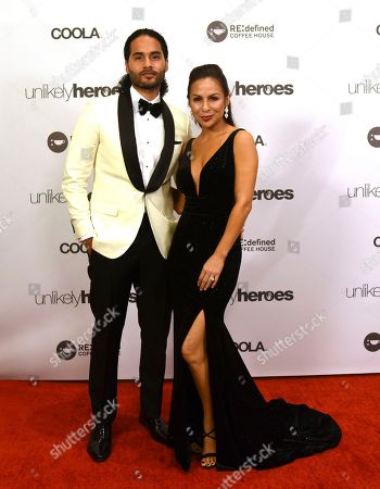 Manuel Reyes, left, and his wife Comedian Anjelah Johnson pose on the red carpet before the Unlikely Heroes 5th Annual Recognizing Heroes Charity Benefit, in Irving, Texas