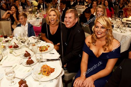 """Julie Chrisley second from left, and her husband Todd from the TV show """"Chrisley Knows Best"""" sit with Erica Greve, founder and CEO of Unlikely Heroes, during the Unlikely Heroes 5th Annual Recognizing Heroes Charity Benefit, in Irving, Texas"""