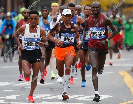 Meb Keflezighi, Ghirmay Ghebreslassie, Wilson Kipsang. Meb Keflezighi, of the United States, center, runs with Ghirmay Ghebreslassie, or Eritrea, left, and Wilson Kipsang, of Kenya, during the New York City Marathon, in New York