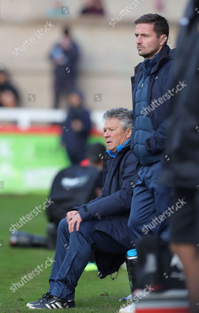 Steve Perryman, Exeter City Director of Football (sitting with Exeter City Assistant Coach, Matt Oakley during the FA Cup First Round, Exeter City v Heybridge Swifts at St James Park on November 5th 2017, Exeter, Devon.
