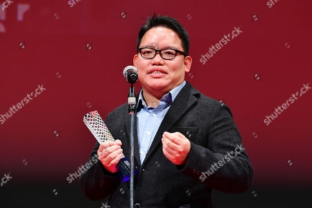 """Stock Picture of Director Edmund Yeo celebrates after winning """"Award for Best Director """" for the film """"AQERAT (We the Dead)"""""""