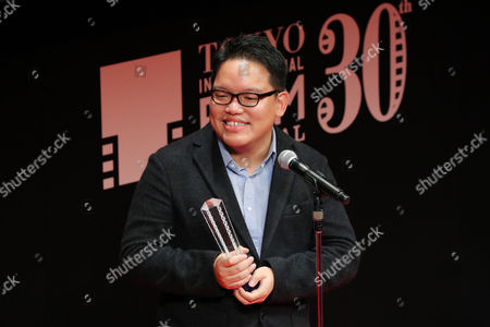 """Director Edmund Yeo speaks after winning """"Award for Best Director """" for the film """"AQERAT (We the Dead)"""""""
