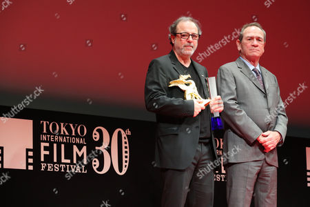 "Stock Picture of (L-R) Semih Kaplanoglu, Tommy Lee Jones - Director Semih Kaplanoglu speaks after winning ""Tokyo Grand Prix/The Governor of Tokyo Award"" for the film ""Grain"""