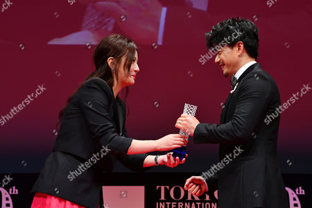 """(L-R) Vicki Zhao, Duan Yihong - Actor Duan Yihong celebrates after winning """"Award for Best Actor """" for the film """"The Looming Storm"""""""