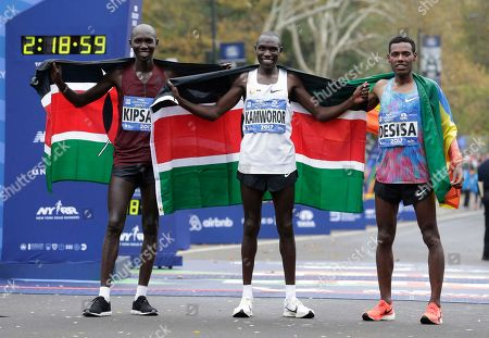 Geoffrey Kamworor, Wilson Kipsang, Lelisa Desisa. Winners of the New York City Marathon pose for pictures at the finish line in New York, . From left, second place Wilson Kipsang of Kenya, first place Geoffrey Kamworor of Kenya and third place Lelisa Desisa of Ethiopia