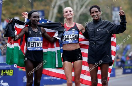 Shalane Flanagan, Mary Keitany, Mamitu Daska. Winners of the marathon pose for pictures at the finish line of the New York City Marathon in New York, . From left, second place Mary Keitany of Kenya, first place Shalane Flanagan of the United States and third place Mamitu Daska of Ethiopia