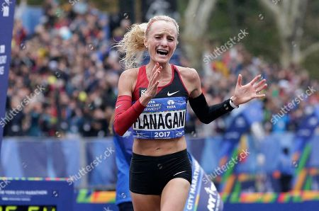 Shalane Flanagan of the United States crosses the finish line first in the women's division of the New York City Marathon in New York