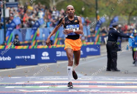 Meb Keflezighi of the United States crosses the finish line of the New York City Marathon in New York
