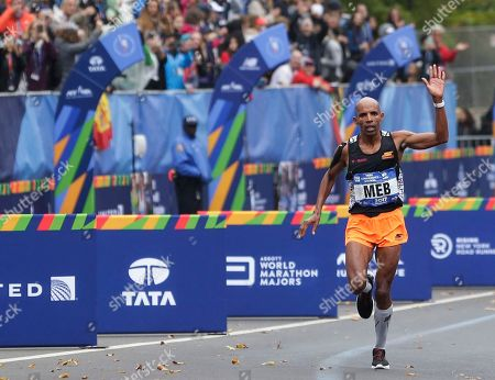 Meb Keflezighi of the United States approaches the finish line of the New York City Marathon in New York