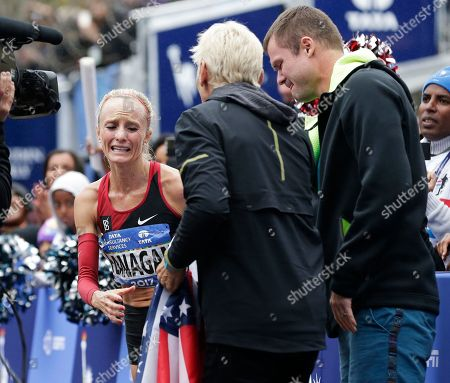 Shalene Flanagan. Shalane Flanagan of the United States reacts after crossing the finish line first in the women's division of the New York City Marathon in New York