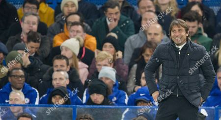 Smiling Chelsea manager Antonio Conte with David Luiz and Michael Emenalo left