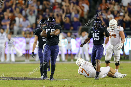 Texas Christian University DT Chris Bradley (56) celebrates a sack of University of Texas QB Shane Buechele (7) during the game between The University of Texas and Texas Christian University at Amon G. Carter Stadium in Fort Worth, Texas