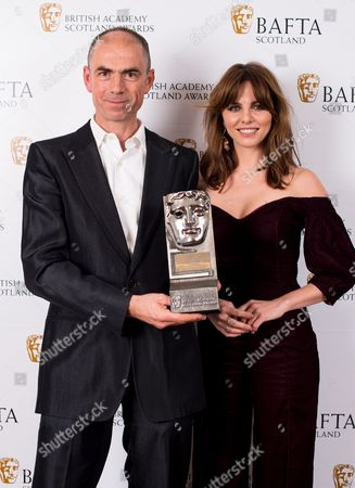 John Hodge accepting on the behalf of Ewen Bremner - Actor Film - T2 Trainspotting with citation reader Ophelia Lovibond