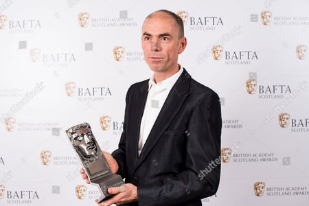 John Hodge accepting on the behalf of Ewen Bremner - Actor Film - T2 Trainspotting