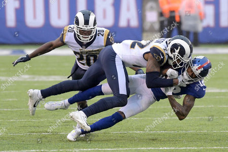 Trumaine Johnson, Tavarres King. Los Angeles Rams cornerback Trumaine Johnson (22) tackles New York Giants wide receiver Tavarres King (12) during the first half of an NFL football game, in East Rutherford, N.J