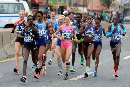 Winner Shalane Flanagan (L) and the elite womens runners approach the 13.1 mile mark on the Pulaski Bridge during the NYC Marathon.