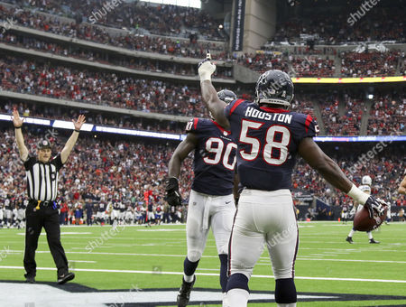 Houston Texans linebacker Lamarr Houston (58) celebrates with outside linebacker Jadeveon Clowney (90) after scoping up a fumble for a touchdown in the second quarter during the NFL game between the Indianapolis Colts and the Houston Texans at NRG Stadium in Houston, TX