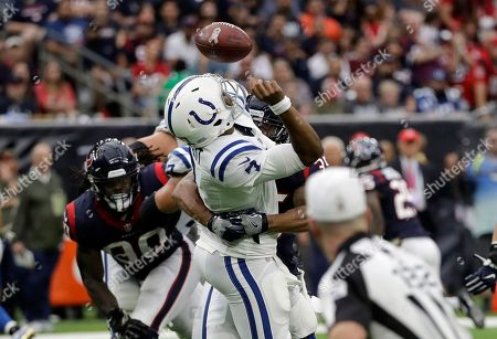 Jacoby Brissett, Eddie Pleasant. Indianapolis Colts quarterback Jacoby Brissett (7) fumbles as he is hit by Houston Texans defensive back Eddie Pleasant (35) during the first half of an NFL football game, in Houston. Texans linebacker Lamarr Houston returned the ball for a touchdown